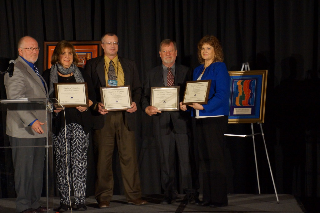 Graduates of the National Dropout Prevention Specialists Certification Program receive their certificates from Dr. Sandy Addis at the 2016 At Risk Youth National FORUM in Myrtle Beach, SC. Pictured are (L to R) Dr. Sandy Addis, Director, National Dropout Prevention Center/Network; Marina Leonidas, Charlotte-Mecklinburg Schools; Dr. C. Wayne Lovell, Mountain Education Charter High School; Dr. Patrick O'Connor, Kent State University; and LeAnn Stewart, AdvancePath Academics.